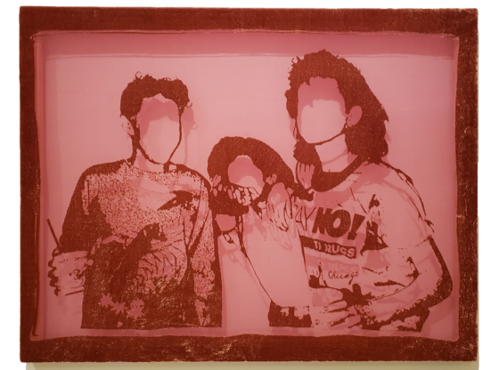 "The photo captures a pink-hued fiber etching made of silk and rayon, depicting three young people in casual wear. One of them wears a t-shirt that prominently displays the slogan ""Say No to Drugs!"" The details of their faces aren't visible, leaving only their hair and the outline of their faces."